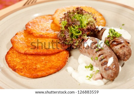 potato pancakes with sausages