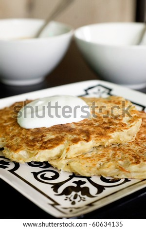 Potato Pancakes with Sour Cream and Warm Applesauce - stock photo