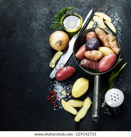 Potato preparation. Fresh organic vegetables. Food background. Healthy food from garden - stock photo
