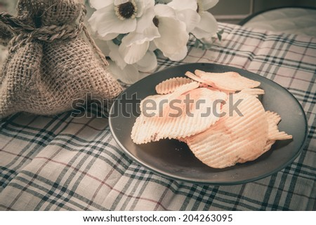 potato, ribbed, delicious, snack, crunchy, chip, crisp, spicy, food, flake, heap, meal, table, crunchy, tasty, crisp, ingredient, crispy, food - stock photo