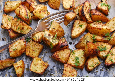 potato roasted with fork - stock photo