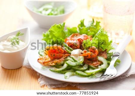 Potato rosti with smoked salmon and cucumber salad - stock photo