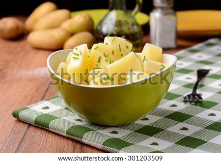 potato salad and chives in green bowl - stock photo
