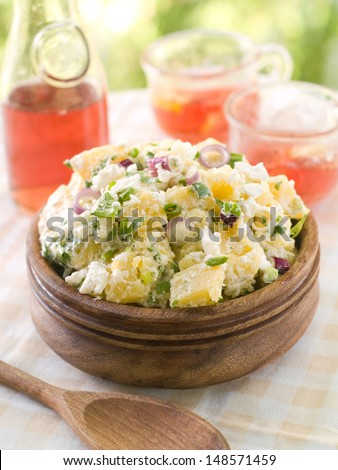 Potato salad with mayonnaise and spring onion, selective focus - stock photo