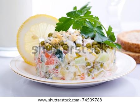 potato salad with parsley and lemon - stock photo