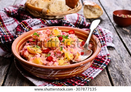 Potato salad with thyme and chili pepper in a ceramic dish