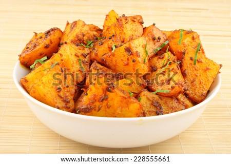Potato stir fry.Shallow depth of field photograph. - stock photo