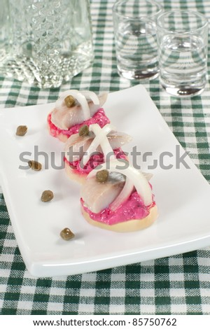 potato tartlets with a herring and mousse from a beet - stock photo