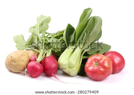 Potato, water radish, rapeseed leaves, tomato on white background - stock photo