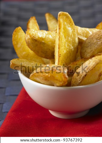 Potato wedges in a white bowl - stock photo