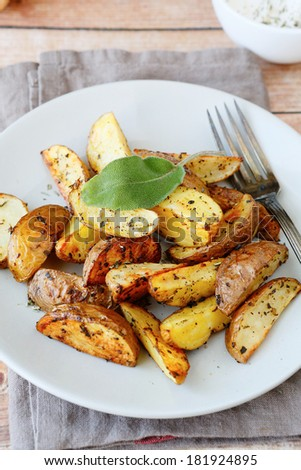 potato wedges with skin baked in the oven, food closeup