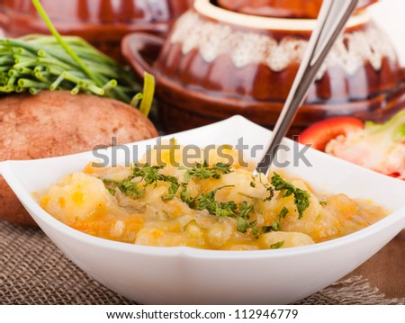 Potato with meat and mushrooms in a pot home-style - stock photo