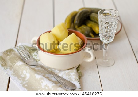 potatoes and pickles, a great snack with vodka - stock photo