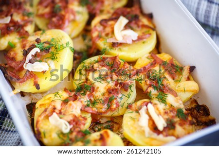 potatoes baked with bacon, cheese and dill - stock photo
