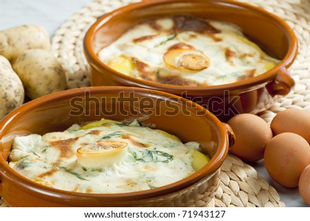 potatoes baked with dill sauce - stock photo