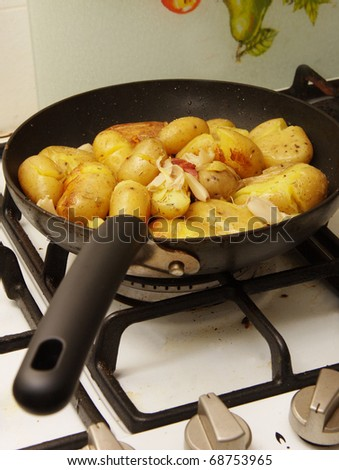 potatoes being fried in a pan - stock photo