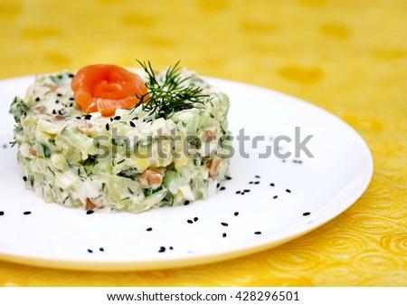 Potatoes cucumber salmon snack salad selective focus - stock photo