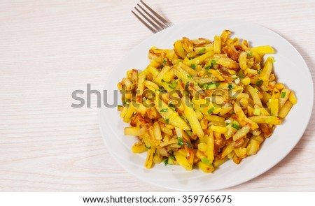 Potatoes fries on the plate