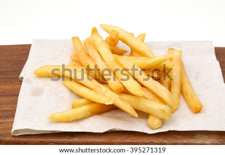Potatoes fries on wooden board