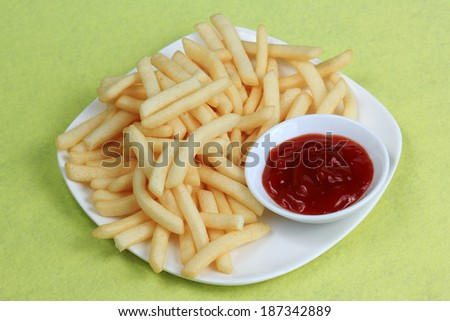 Potatoes fries with ketchup in the plate ready for served - stock photo