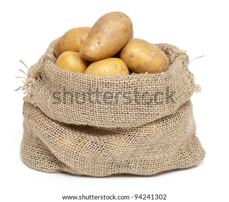 potatoes in a burlap bag isolated on white background
