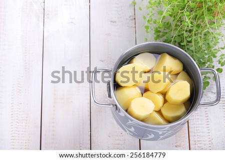Potatoes in a cooking pot - stock photo