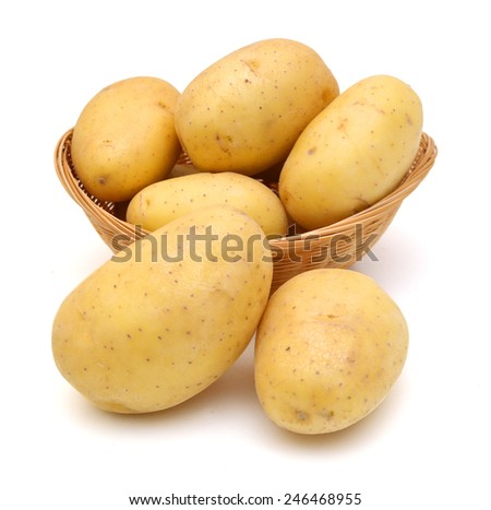 potatoes in basket on white background