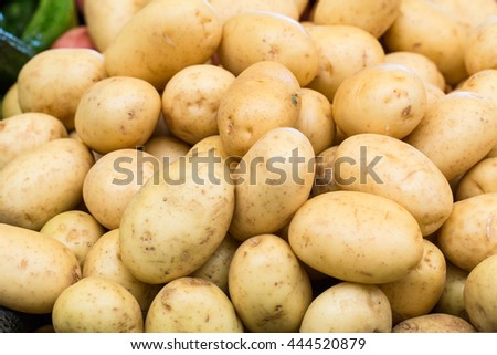 Potatoes in bin for sale at farmers market in Asheville North Carolina
