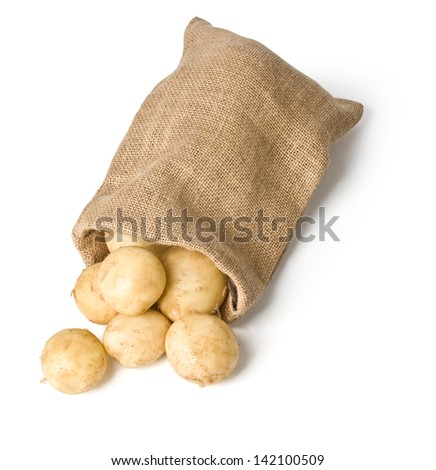 potatoes in burlap sack on white background with clipping path - stock photo