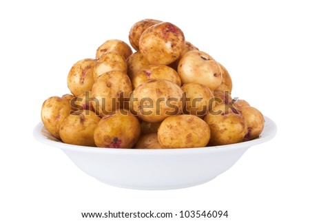 potatoes in plate isolated on a white background