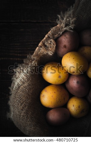 Potatoes mix on the dish with canvas on the wooden table vertical