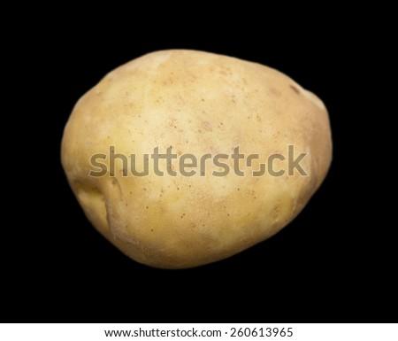 potatoes on a black background - stock photo