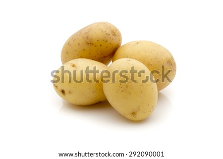 Potatoes on the white background.  New harvest. - stock photo