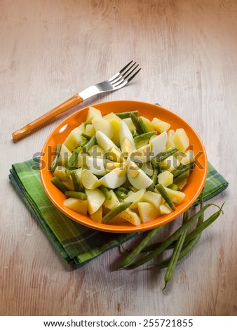 potatoes salad with  green beans and boiled eggs - stock photo