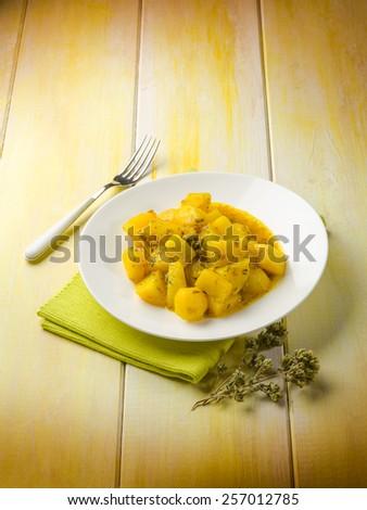 potatoes salad with saffron and oregano - stock photo