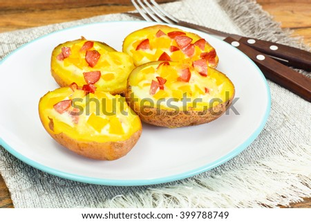 Potatoes Stuffed with Salami Sausage and Yellow Peppers Studio Photo