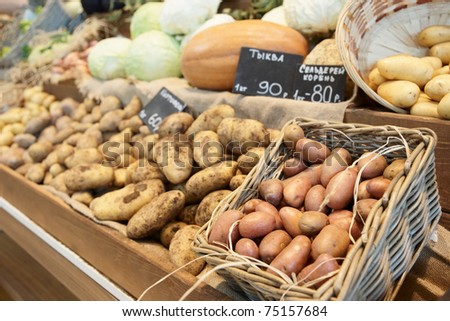 Potatos and another vegetables on farmer's market - stock photo