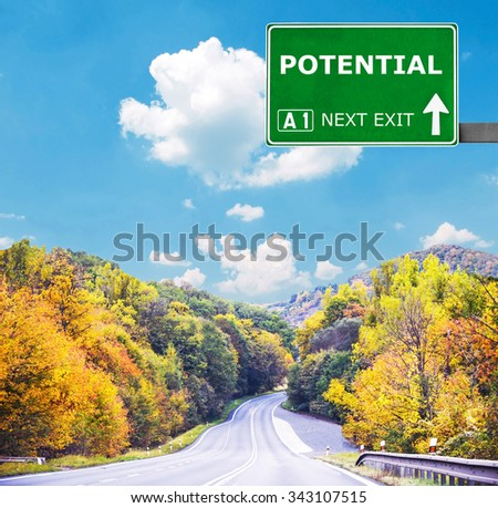 POTENTIAL road sign against clear blue sky - stock photo