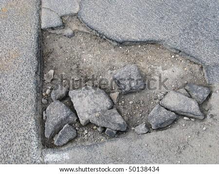 Pothole on the road - stock photo