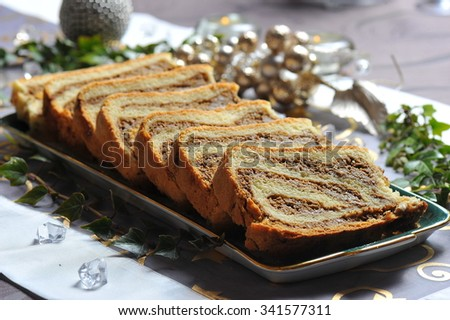 Potica/Potizza, Roll with walnuts on the festive table - stock photo