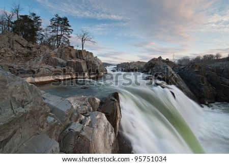 Potomac River Great Falls Waterfall--America's wildest urban river cuts through the Potomac Gorge en route to the Nation's Capital some fifteen miles downstream - stock photo