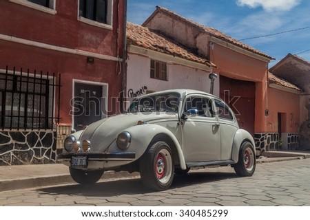 POTOSI, BOLIVIA - APRIL 19, 2015: Classic Volkswagen Beetle parked in a center of Potosi, Bolivia - stock photo