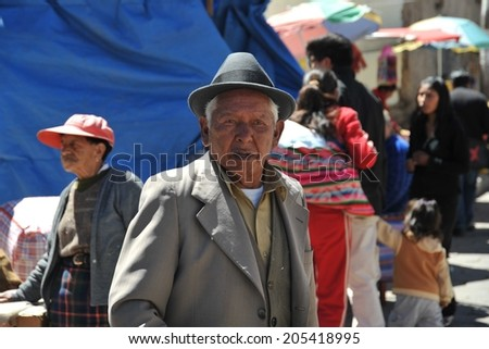 POTOSI, BOLIVIA - SEPTEMBER 8, 2010: Potosi  is one of the highest cities in  world. History City is closely connected with extraction of rich deposits of silver. Local inhabitants on the city streets