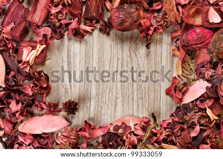 potpourri, aromatic mix over wooden background