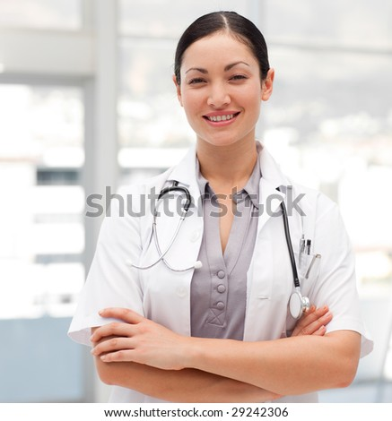 Potrait of a Happy Female Doctor with smiling at camera - stock photo