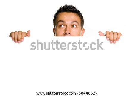 Potrait of a happy young guy holding blank billboard - stock photo