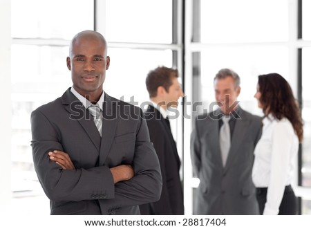Potrait of a Young Businessman standing out from the Crowd - stock photo