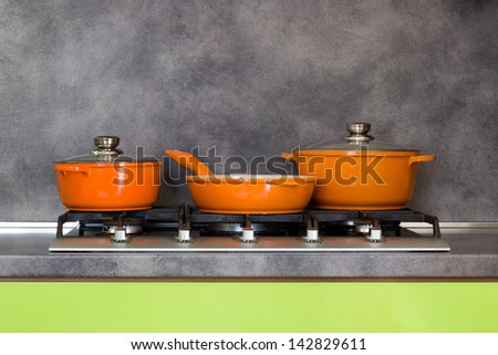 Pots and pan on the stove - modern kitchen - stock photo