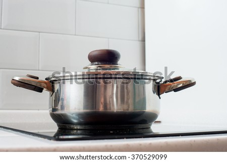 Pots and Pans cooking on stove 1 - stock photo