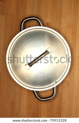 Pots and pans on a wooden kitchen bench - stock photo